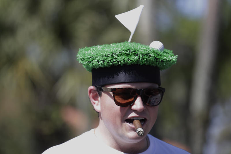 Golf fan Nick Walker, watches the action from the eight hole, during the first round of The Players Championship golf tournament Thursday, March 12, 2020, in Ponte Vedra Beach, Fla. (AP Photo/Chris O'Meara)