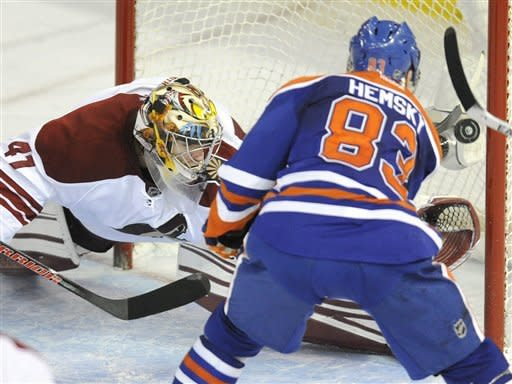 Edmonton Oilers' Ales Hemsky (83) scores on Phoenix Coyotes goaltender Mike Smith during the second period of an NHL hockey game in Edmonton on Sunday, March 18, 2012. (AP Photo/The Canadian Press, John Ulan)