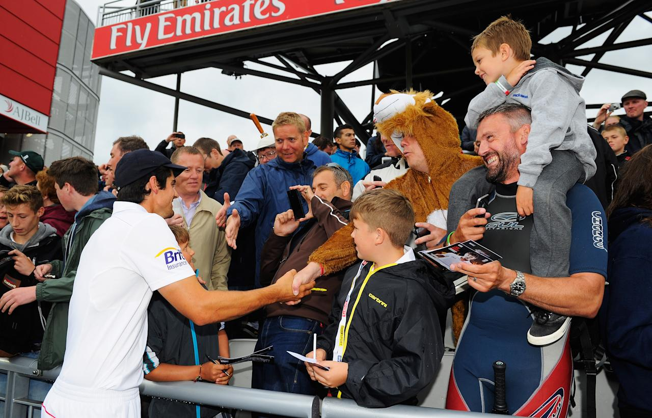 MANCHESTER, ENGLAND - AUGUST 05:  Alastair Cook, captain of England celebrates with fans after England retained the Ashes during day five of the 3rd Investec Ashes Test match between England and Australia at Emirates Old Trafford Cricket Ground on August 5, 2013 in Manchester, England.  (Photo by Stu Forster/Getty Images)