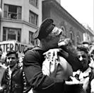<p>A couple kisses in Times Square as they partake in V-E Day celebrations.</p>