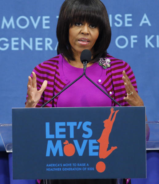 "First lady Michelle Obama speaks at a ""Let's Move!"" event for 400 children at the Eastside and Northside Elementary Schools in Clinton, Miss., Wednesday, Feb. 27, 2013. Obama and television chef/personality Rachel Ray visited with the children and conducted a cooking contest between the schools chefs. (AP Photo/Rogelio V. Solis)"