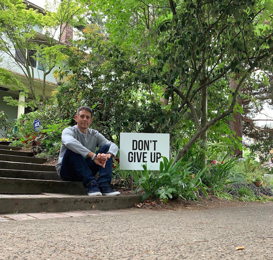Seattle father Colby Wallace is spreading encouragement through motivational signs. (Photo: Courtesy of Colby Wallace)