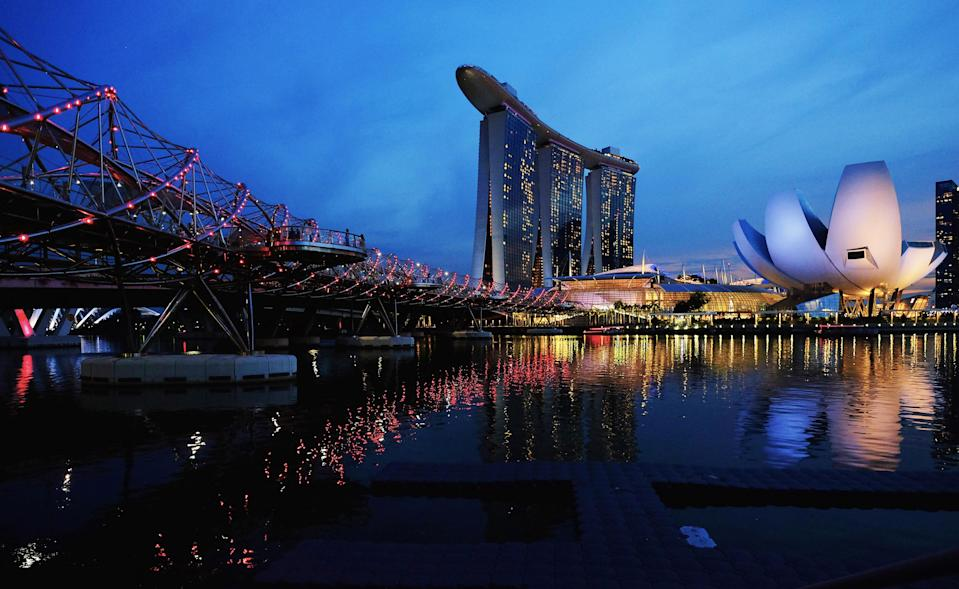 The Helix Bridge is seen next to the Marina Bay Sands integrated resort. Photo: REUTERS/Kevin Lam)