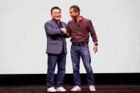 TM Roh of Samsung Electronics shakes hands with Hiroshi Lockheimer of Google during Samsung Galaxy Unpacked 2020 in San Francisco