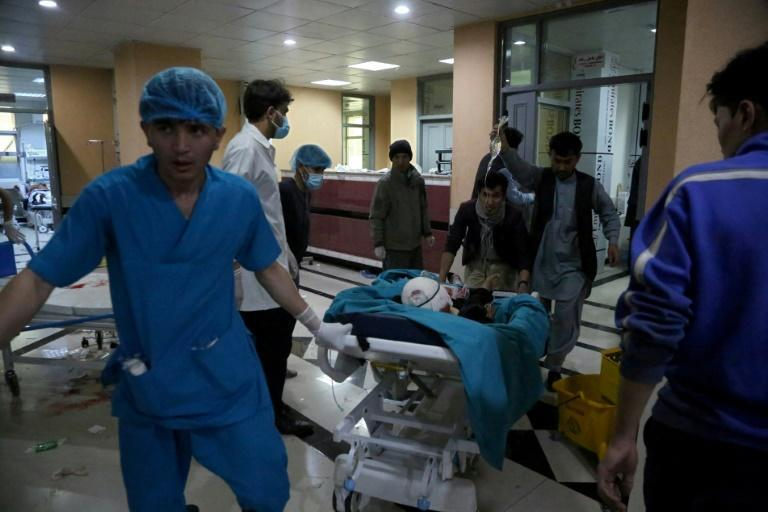 An injured man is being brought on a stretcher to a hospital following a blast outside a school in the west Kabul district of Dasht-e-Barchi