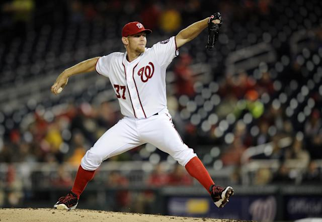 Washington Nationals starting pitcher Stephen Strasburg delivers a pitch against the San Diego Padres during the fourth inning of a baseball game, Friday, April 25, 2014, in Washington. (AP Photo/Nick Wass)
