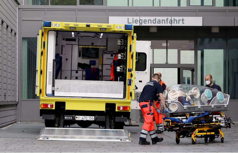 Paramedics load a stretcher into an ambulance that allegedly transported Russian opposition leader Alexei Navalny at Charite Mitte Hospital Complex where he will receive medical treatment in Berlin, Germany August 22, 2020. REUTERS/Christian Mang