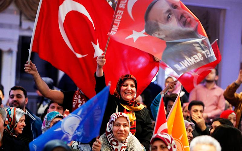 Mr Erdogan's vistory was celebrated by his supporters - Credit: Michael Probst / AP