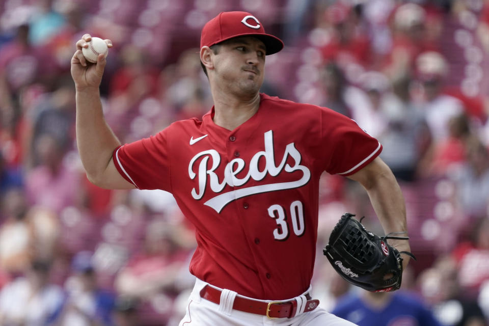 Cincinnati Reds starting pitcher Tyler Mahle (30) throws during the first inning of a baseball game against the Chicago Cubs in Cincinnati, Wednesday, Aug. 18, 2021. (AP Photo/Jeff Dean)