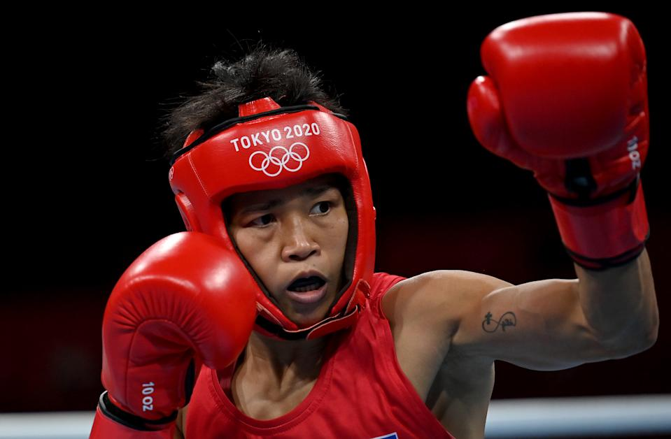 TOKYO, JAPAN - JULY 29: Irish Magno of Team Philippines in action against Jutamas Jitpong of Team Thailand during the Women's Fly (48-51kg) on day six of the Tokyo 2020 Olympic Games at Kokugikan Arena on July 29, 2021 in Tokyo, Japan. (Photo by Luis Robayo - Pool/Getty Images)