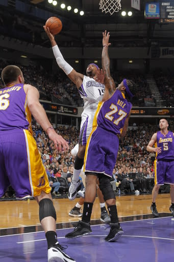 SACRAMENTO, CA - APRIL 26: DeMarcus Cousins #15 of the Sacramento Kings takes the ball to the basket against Jordan Hill #27 of the Los Angeles Lakers on April 26, 2012 at Power Balance Pavilion in Sacramento, California. (Photo by Rocky Widner/NBAE via Getty Images)