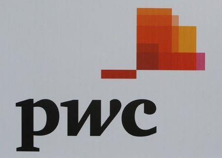 The logo of accounting firm PwC is seen on a board at the SPIEF 2017 in St. Petersburg