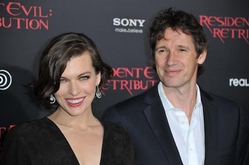 """Milla Jovovich, left, and Paul W.S. Anderson attend the US premiere of """"Resident Evil: Retribution"""" at Regal Cinemas L.A. Live on Wednesday, Sept. 12, 2012 in Los Angeles. (Photo by Richard Shotwell/Invision/AP)"""