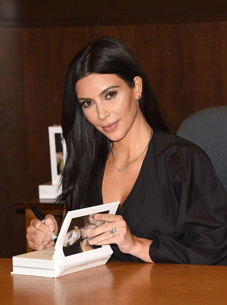 "<p>In 2015, Kardashian released her first book - a coffee table photobook full of selfies entitled Selfish. In an interview with <a href=""https://abcnews.go.com/Entertainment/kim-kardashian-talks-selfies-upcoming-book-release/story?id=29326073"" rel=""nofollow noopener"" target=""_blank"" data-ylk=""slk:AdWeek"" class=""link rapid-noclick-resp"">AdWeek</a> Kim, who was dubbed the Queen of Selfies at the time, said she took her first one in 1984.</p>"