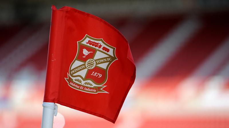Swindon confirmed as League Two champions as clubs vote to end the season