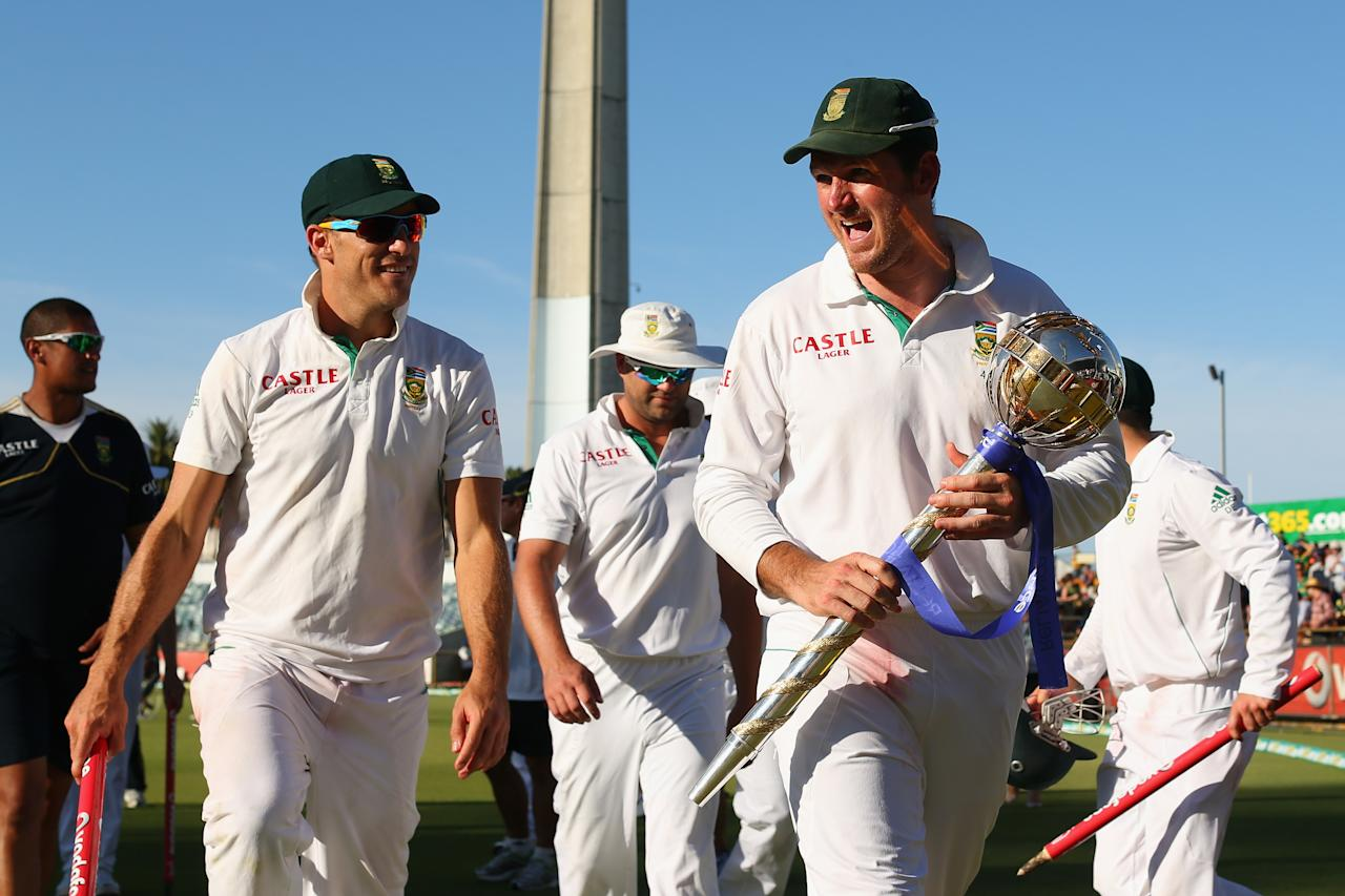 PERTH, AUSTRALIA - DECEMBER 03:  South African captain Graeme Smith walks off the field with team mate Faf du Plessis and the ICC Test Championship mace after winning the series during day four of the Third Test Match between Australia and South Africa at the WACA on December 3, 2012 in Perth, Australia.  (Photo by Cameron Spencer/Getty Images)