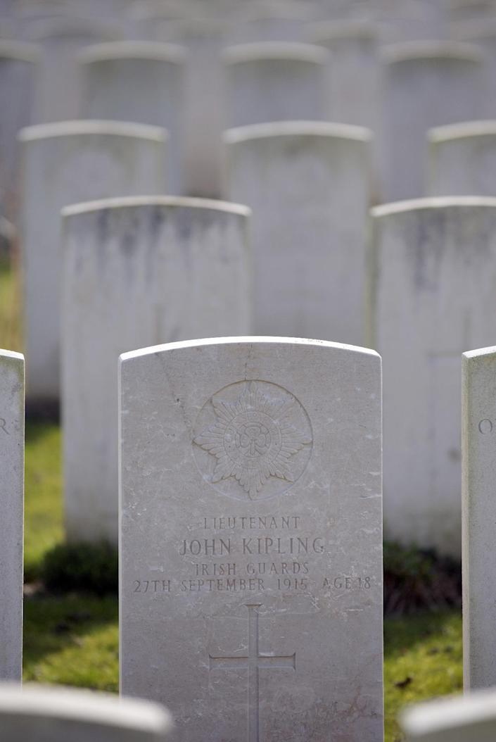 The gravestone of writer Rudyard Kipling's only son, Lt. John Kipling, stands among other World War One graves at St. Mary's Advanced Dressing Station Cemetery in Haisnes, France on Thursday, March 13, 2014. After his only son was killed in the Battle of Loos, Rudyard Kipling became an influential member of the Imperial War Graves Commission, later renamed the Commonwealth War Graves Commission, which established the standard gravestone of Portland stone, seen in Commonwealth cemeteries around the world. It was Kipling who suggested the phrase 'Their Name Liveth For Evermore' for memorial markers, and 'Known unto God', for the graves of those soldiers who bodies could not be identified. (AP Photo/Virginia Mayo)