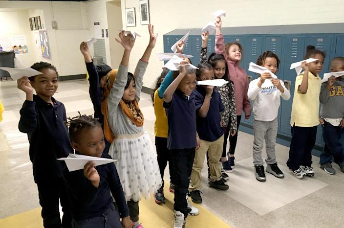 Image: At Arthur O. Eve #61 on Buffalo's east side, Sarah Malczewski's first grade gifted class prepares to launch the paper airplanes they designed to fly as far as possible. (Danielle Dreilinger for The Hechinger Report)