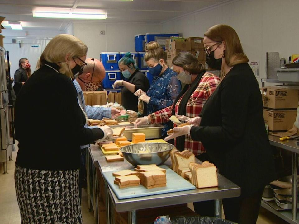 Volunteers pack lunches on Leo Hayes High School campus in December 2020. (CBC News/Mike Heenan - image credit)