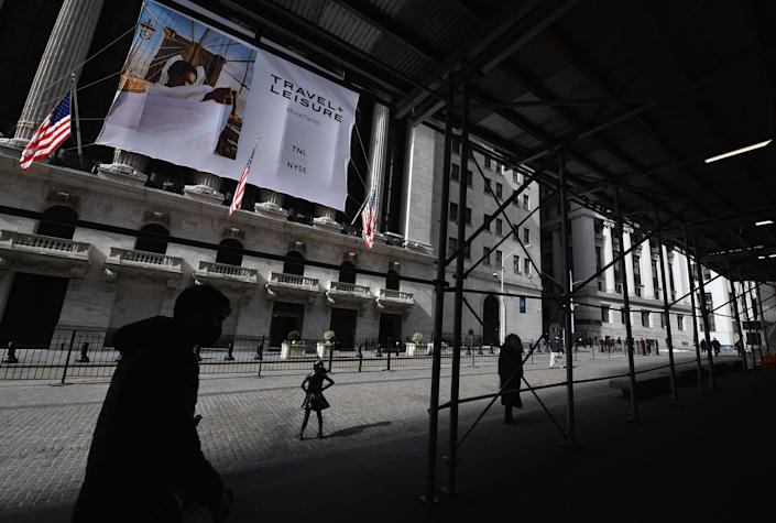 People walk past the New York Stock Exchange (NYSE) at Wall Street on February 17, 2021 in New York City. (Photo by Angela Weiss / AFP) (Photo by ANGELA WEISS/AFP via Getty Images)