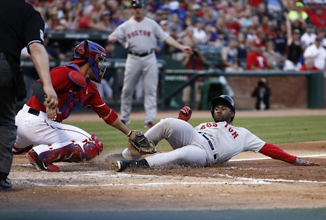 Texas Rangers catcher Robinson Chirinos, left, tags out Boston Red Sox's Jackie Bradley Jr. (25) attempting to score on a hit by Red Sox's Shane Victorino during the second inning of a baseball game, Saturday, May 10, 2014, in Arlington, Texas. (AP Photo/Jim Cowsert)