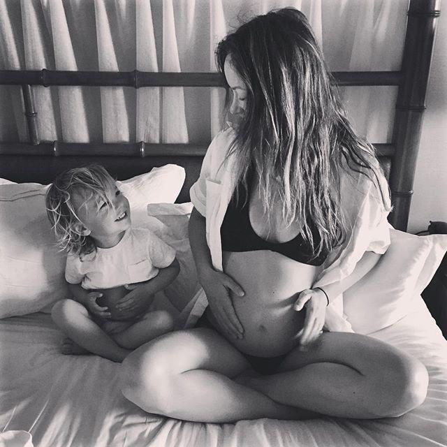 "<p>The actress announced she was pregnant with her second child on Instagram by sharing a black-and-white photo of herself cradling her bump while sat beside her son Otis. </p><p>'Matching baby bumps,' the star captioned the sweet photo. Wilde is married to actor Jason Sudeikis. </p><p><a href=""https://www.instagram.com/p/BEWhjo-shgU/?utm_source=ig_web_copy_link"" rel=""nofollow noopener"" target=""_blank"" data-ylk=""slk:See the original post on Instagram"" class=""link rapid-noclick-resp"">See the original post on Instagram</a></p>"