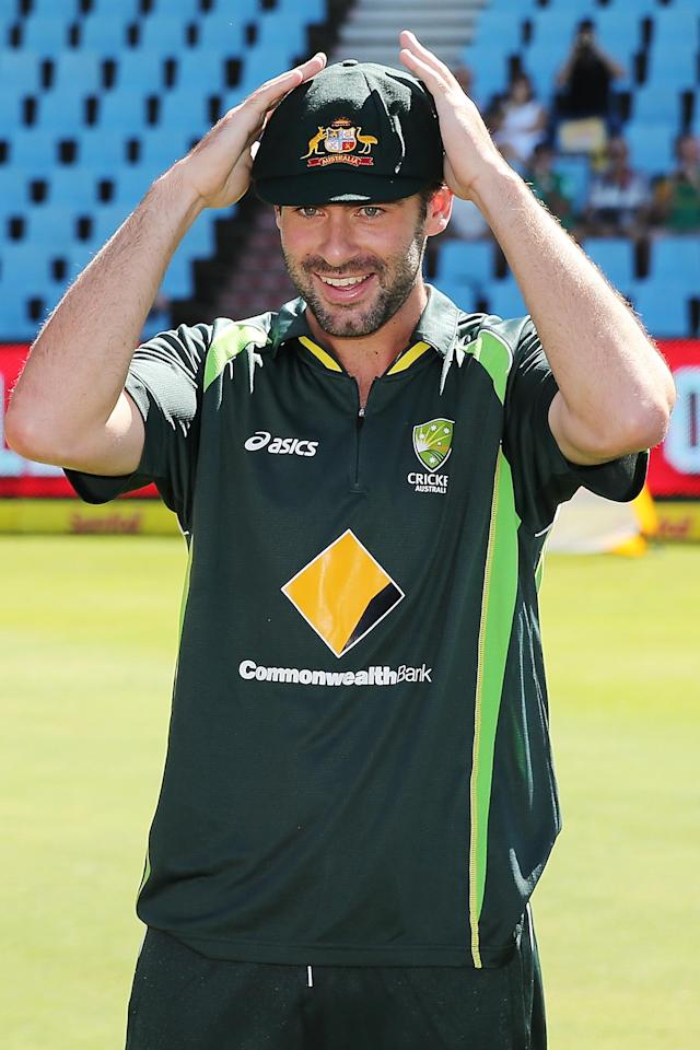 CENTURION, SOUTH AFRICA - FEBRUARY 12: Alex Doolan of Australia is congratulated by teammates after receiving his cap before day one of the First Test match between South Africa and Australia on February 12, 2014 in Centurion, South Africa. (Photo by Morne de Klerk/Getty Images)