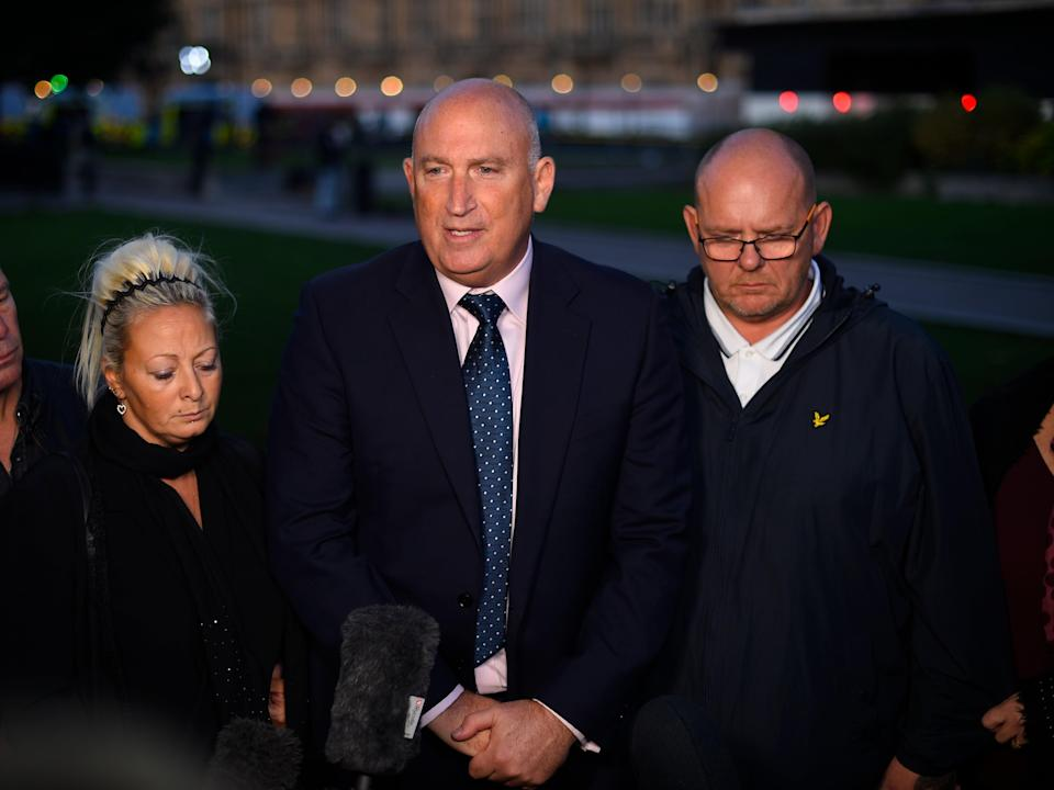The parents of Harry Dunn, Charlotte Charles and Tim Dunn, pictured with family spokesman Radd Seiger (centre). (Peter Summers/Getty Images)