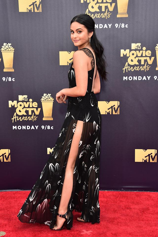 <p>Wearing a black printed gown by Elisabetta Franchi.</p>