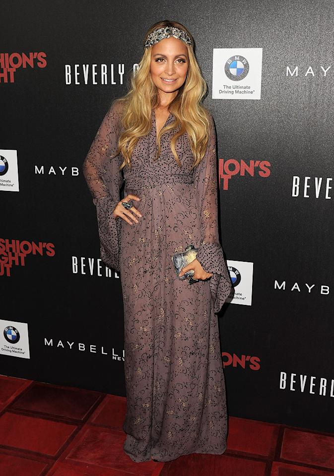 """Not too far away, designer Nicole Richie checked out the event at L.A.'s Beverly Center decked out in her usual boho style. What did you think of her silver headband and billowy, long-sleeved dress? Hot ... or not? Jordan Strauss/<a href=""""http://www.wireimage.com"""" target=""""new"""">WireImage.com</a>"""
