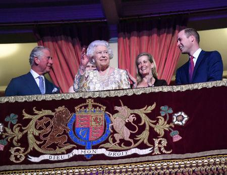 "Britain's Queen Elizabeth waves next to Prince Charles and Prince William, Duke of Cambridge, during a special concert ""The Queen's Birthday Party"" to celebrate her 92nd birthday at the Royal Albert Hall in London, Britain April 21, 2018. Andrew Parsons/Pool via Reuters"
