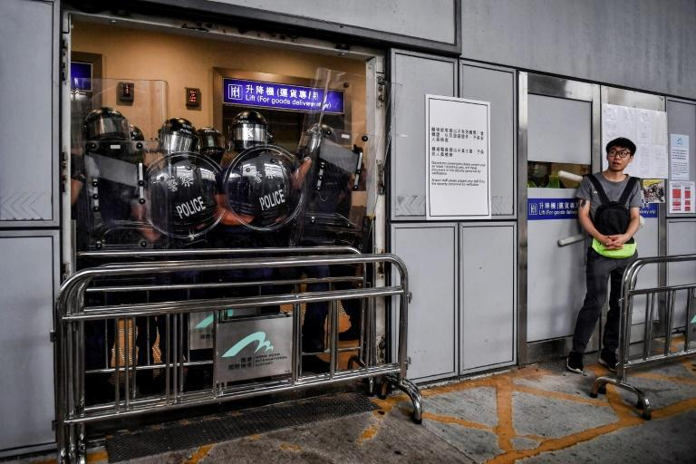 Riot police block an entrance at Hong Kong International Airport on September 1 to stop protesters from entering the terminal building (AFP Photo/Lillian SUWANRUMPHA)