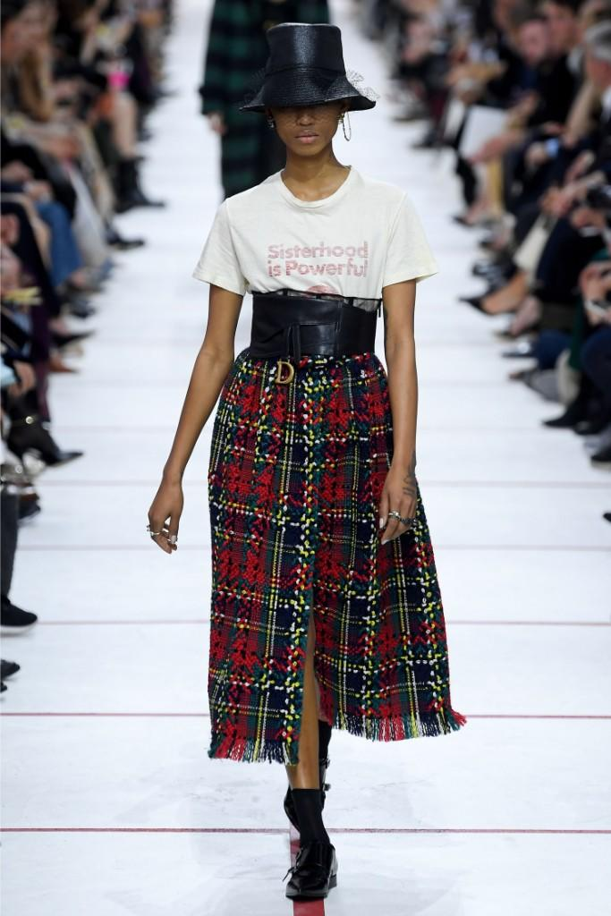 A model in a plaid skirt and boots at Dior.