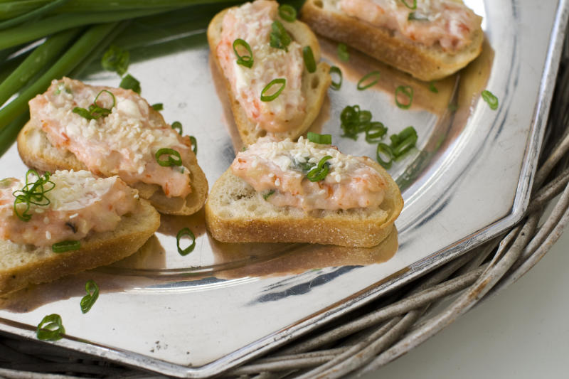 In this image taken on January 14, 2013, baked sesame shrimp toasts are shown served on a tray in Concord, N.H. (AP Photo/Matthew Mead)