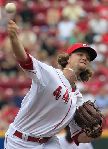 Cincinnati Reds starting pitcher Mike Leake throws to the St. Louis Cardinals in the first inning of a baseball game, Saturday, July 14, 2012, in Cincinnati. (AP Photo/Al Behrman)