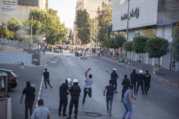 Palestinian riot police and plainclothes security officers clash with protesters following a demonstration against the death of Nizar Banat, a critic of the Palestinian Authority, in the West Bank city of Ramallah, Saturday, June 26, 2021. (AP Photo/Nasser Nasser)