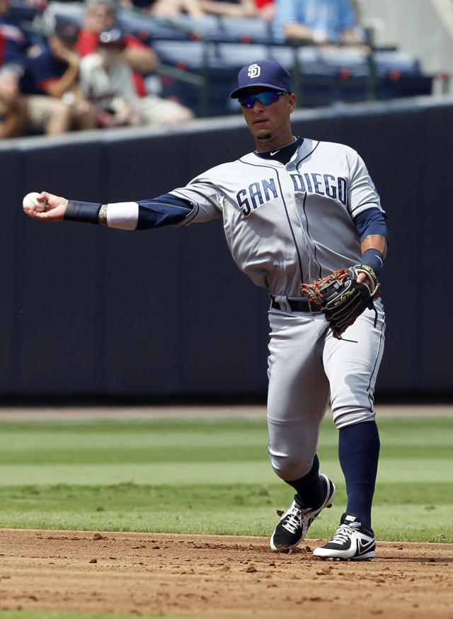 San Diego Padres shortstop Ronny Cedeno (3) throws to first in the fifth inning of a baseball game against the Atlanta Braves at Turner Field on Sunday, Sept. 15, 2013, in Atlanta. (AP Photo/Butch Dill)