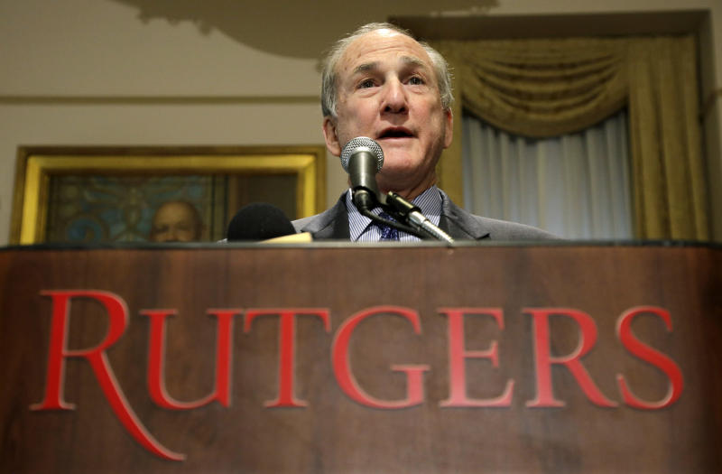 FILE - In this April 5, 2013, file photo, Rutgers President Robert Barchi announces that he had accepted the resignation of athletic director Tim Pernetti during news conference in New Brunswick, N.J. The school's Board of Governors plans to discuss hiring an adviser to report on former basketball coach Mike Rice's behavior and how the university handled it. (AP Photo/Mel Evans, File)