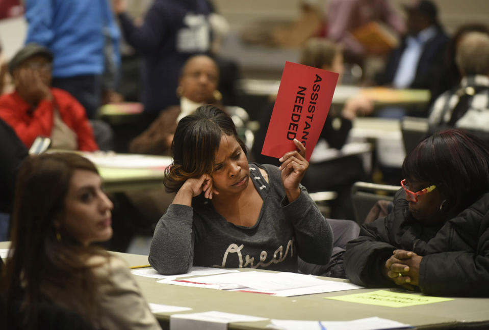Vonettia Midgett, of Detroit, awaits assistance as the massive recounting of ballots begins for Wayne County's portion of the presidential election in Detroit on Dec. 6, 2016. (Max Ortiz / Detroit News via AP file)