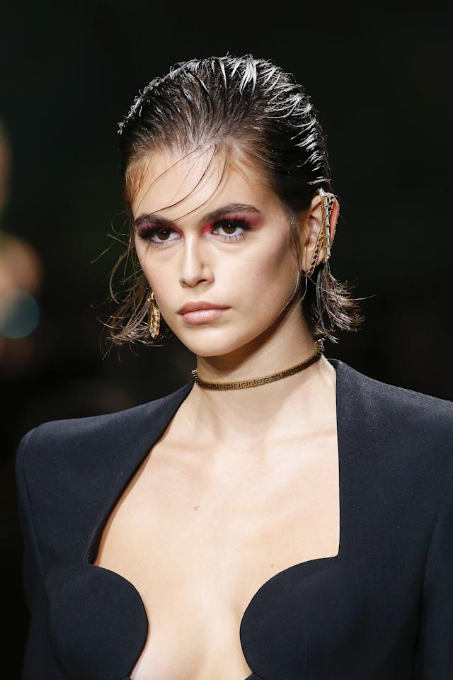 <p>Gerber wore a neon pop of pink in the corners of her eyes paired with a just-washed bob haircut that made for a strong runway look.</p>