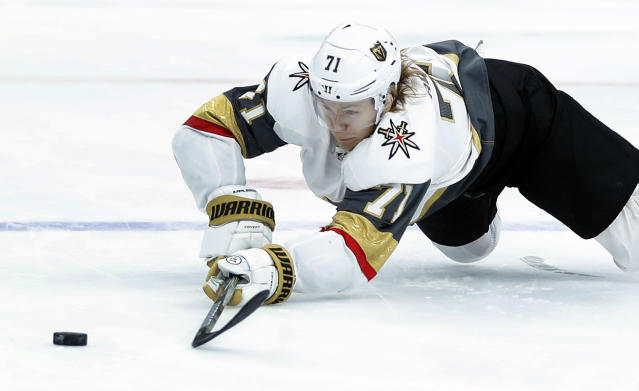 Vegas Golden Knights' William Karlsson, of Sweden, reaches for a loose puck during the first period of an NHL hockey game against the St. Louis Blues Thursday, Nov. 1, 2018, in St. Louis. (AP Photo/Jeff Roberson)