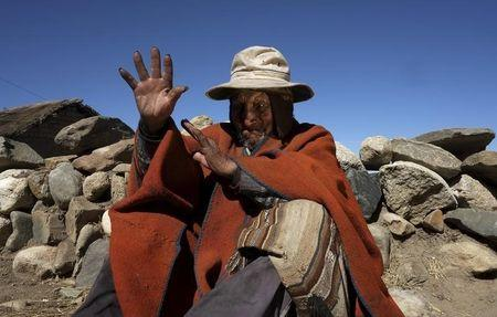 Aymara Indian Flores gestures during an interview with Reuters TV in his hometown of Frasquia