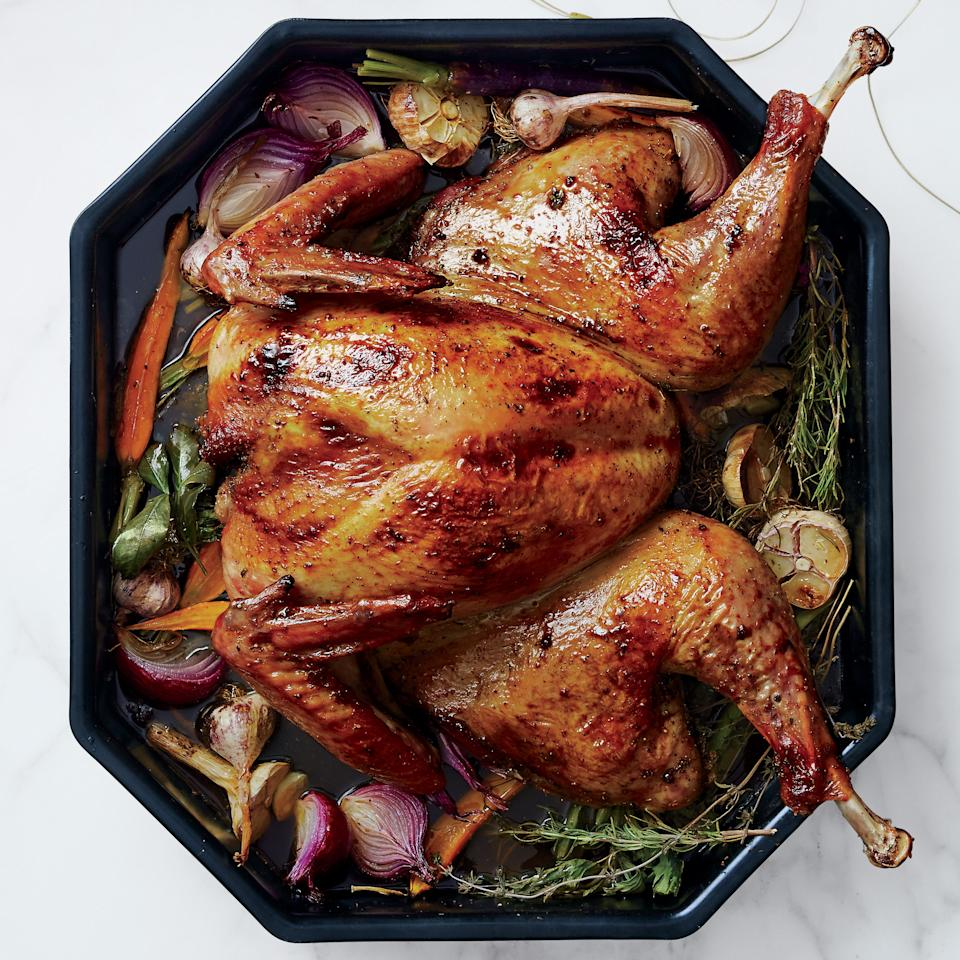 "Spatchcocking means a turkey that cooks faster, more evenly, and takes up less space in your oven: all good things when you're preparing an entire Thanksgiving feast. <a href=""https://www.epicurious.com/recipes/food/views/spatchcocked-turkey-with-anise-and-orange-51255070?mbid=synd_yahoo_rss"">See recipe.</a>"
