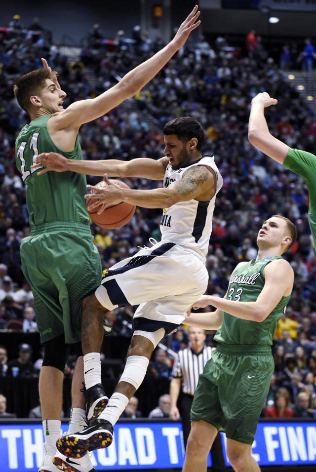 Marshall forward Ajdin Penava (11) defends as West Virginia guard Daxter Miles Jr. (4) drives with the ball during the first half of a second-round NCAA college basketball tournament game Sunday, March 18, 2018, in San Diego. (AP Photo/Denis Poroy)