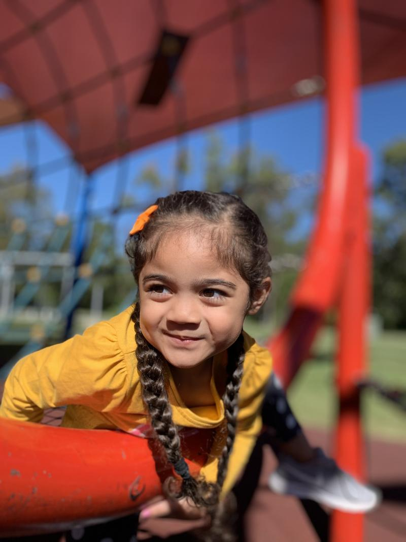 Lani is pictured smiling in a playground. Source: Supplied