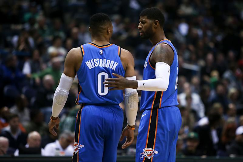 MILWAUKEE, WI - OCTOBER 31: Russell Westbrook #0 and Paul George #13 of the Oklahoma City Thunder meet in the third quarter against the Milwaukee Bucks at the Bradley Center on October 31, 2017 in Milwaukee, Wisconsin. NOTE TO USER: User expressly acknowledges and agrees that, by downloading and or using this photograph, User is consenting to the terms and conditions of the Getty Images License Agreement. (Photo by Dylan Buell/Getty Images)