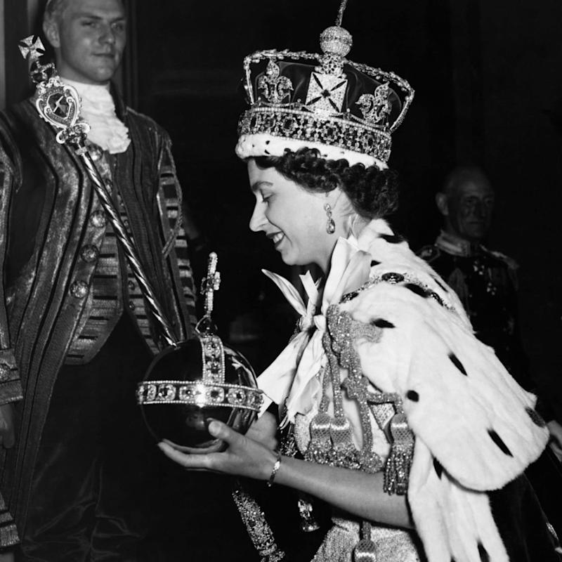 The Queen arrives at Buckingham Palace after her coronation in 1953 - Corbis Historical