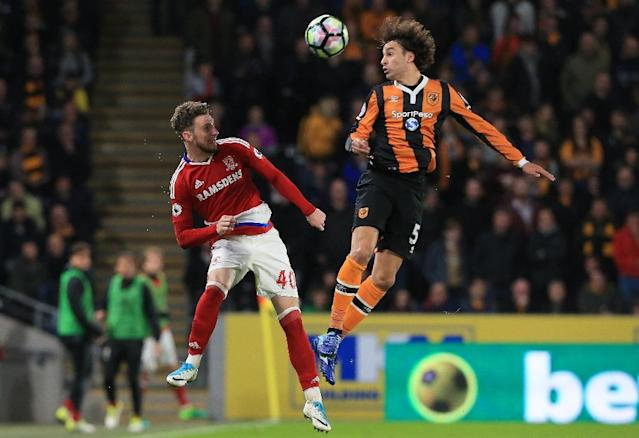 Middlesbrough's defender James Husband (L) vies with Hull City's midfielder Lazar Marković during the English Premier League football match between Hull City and Middlesbrough at the KCOM Stadium in Kingston upon Hull, on April 5, 2017 (AFP Photo/Lindsey PARNABY)