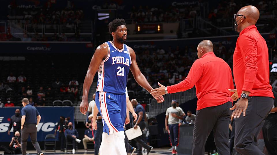 Seen here, Joel Embiid leaves the court for the Sixers against the Wizards.