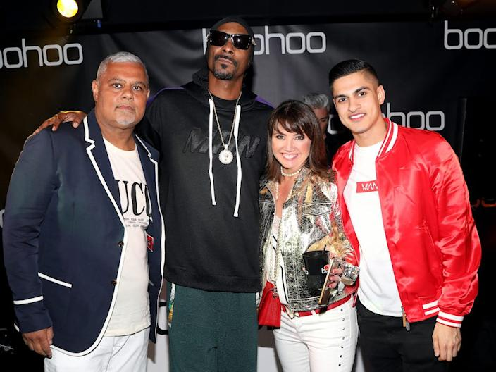 Mahmud Kamani (L) is photographed with rapper Snoop Dogg, business partner Carol Kane, and his son, Samir.